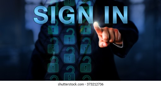 Entrepreneur in business suit is pointing at SIGN IN on a touch screen interface. Unlocked padlock icons do represent authorized computing access upon successful identification and authentication.