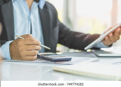 entrepreneur calculate financial cost. Businessman planning to extend business and calculating budget for develop and prepare to talk with bank to request financial loan.