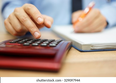 Entrepreneur calculating and reviewing investment plan