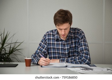 entrepreneur in casual clothes looks carefully at the documents and write notes in your task