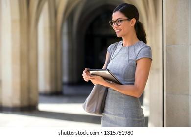 Entrepreneur enjoying the convenience of modern technology tablet, internet, broadband, wifi, digital network