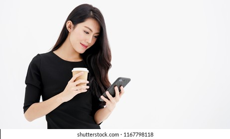 Entrepreneur pretty woman holding coffee cup and touching screen on smart phone mobile on white background, attractive asian people drink beverage  smart, Technology communication lifestyles concept.