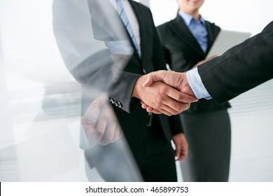Entrepreneur shaking hand of his business partner