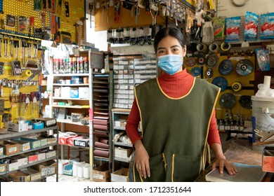 Entrepreneur woman in his business working with face masks during quarantine for the epidemic of disease caused by COVID-19.