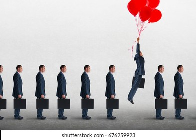 entrepreneurial business concept businessman rising above a queue of businessmen with helium balloons