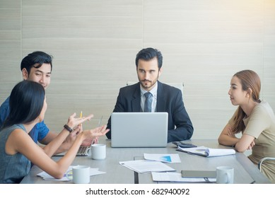 Entrepreneurs and Business People discussing together in conference room during meeting at office, teamwork concept.