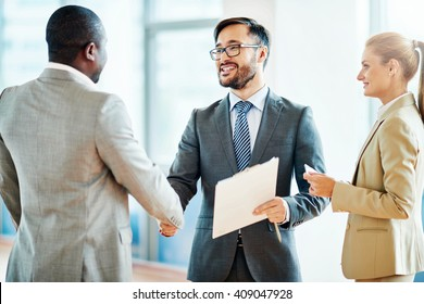 Entrepreneurs meeting and shaking hands