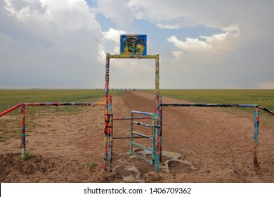 Entry gate to Cadillac Ranch, located originally along Route 66 and currently along Interstate 40 is a public art sculpture of Cadillacs buried in a field - Amarillo, Texas, USA - May 23, 2019