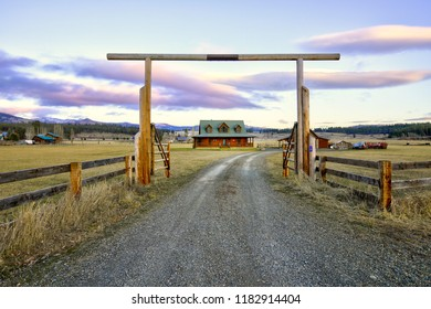 Entry gate to a nice wooden ranch home with beautiful landscape. Northwest, USA.