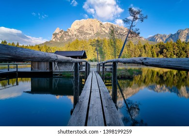 the entry to the picturescue mountain lake, Völser Weiher in Südtirol, Reflection of mountain in lake, Longexposure Landscape, Dolomites