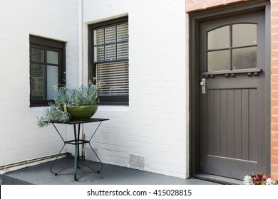 Entry porch and front door of an art decor style apartment in Australia
