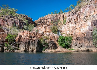 Entry up the stairs to a secluded lily pond where is safe to swim with no crocodiles, a stop over during the cruise tour of Katherine Gorge in Nitmiluk National Park, Northern Territory, Australia.