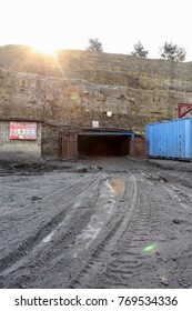 Entry to an underground Coal mine. Dangerous work. Fiery Mine. Entrance to mining tunnel.