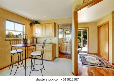 Entryway of duplex house. View of dining area with cabinets. Northwest, USA