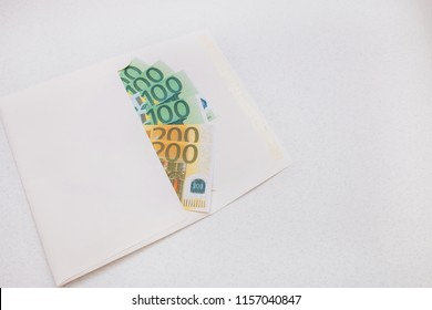 envelope with 100 and 200 Euro banknotes on white background