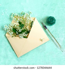 Envelope with blossoming branch of bird cherry, pen and ink. Concept of spring holidays. Congratulations on Women's Day, Mother's Day. Minimal style