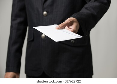 Envelope with a bribe for you ,Photography in the studio in the corruption concept.