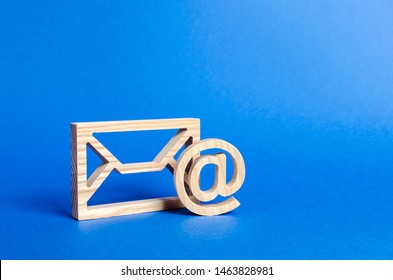 Envelope and email symbol on a blue background. Concept email address. Internet technologies and contacts for communication. Communication over the network, business and correspondence.
