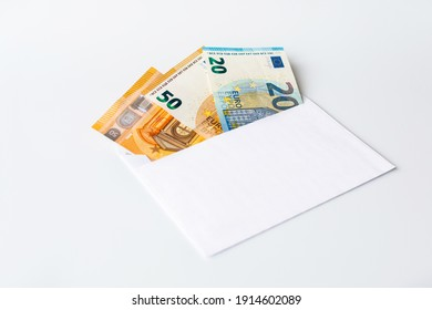 Envelope with euro banknotes on a white background.