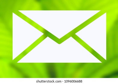 Envelope with green nature background