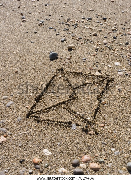 The envelope with the letter is drawn on wet sea sand