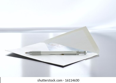 Envelope with the letter on the writing desk against the bright background