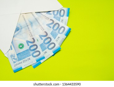 Envelope with money isolated on the green background