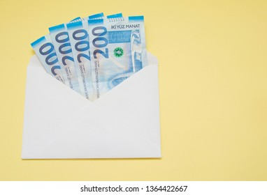 An envelope with money isolated on the yellow background