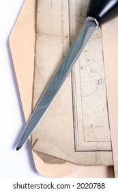 Envelope opened with letter opener to reveal old map