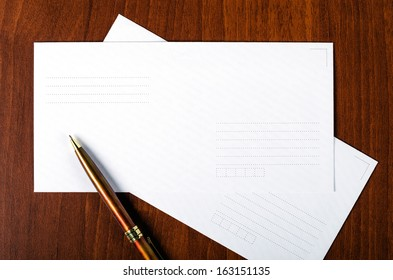 Envelope with a pen on the table