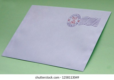 Envelope with postal stamp illustrating the concept of blackmail for extortion