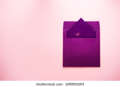 Envelope with a postcard and butterfly decoration. For letters, invitation and congratulations.