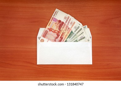 Envelope With Russian currency lying on the table