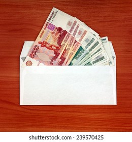 Envelope With Russian currency on the table closeup