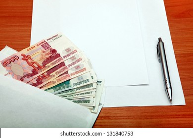 Envelope with a Russian Money and Empty Paper for Text on the Wooden Table