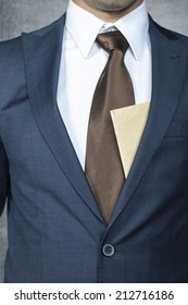envelope sticking out from behind the suit