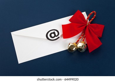 Envelope with at Symbol, concept of christmas E-Mail