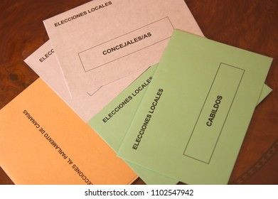Envelopes for the Elections on Canary Islands: envelopes and ballots.  Letters with ELECCIONES AL PARLAMENTO and ELECCIONES LOCALES means in English ELECTIONS TO PARLIAMENT and LOCAL ELECTIONS