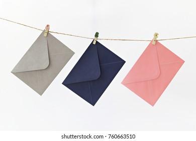 Envelopes hanging on string isolated on white background