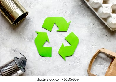 environment concept with recycling symbol on stone background top view mock-up