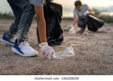 Environment concept.Diverse Group of People Picking Up Trash in The Park Volunteer Community Service.Save earth