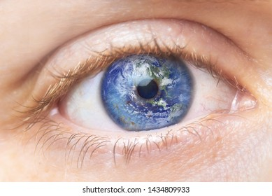 Environment conservation concept. Close up image of woman eye with earth in it. Creative composite of macro Eye with Earth as Iris. Elements of this image furnished by NASA .