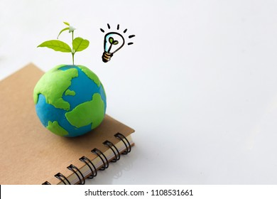Environment conservation idea concept , earth and light bulb with plant