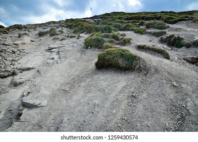 environment destruction, soil erosion on a mountain slope