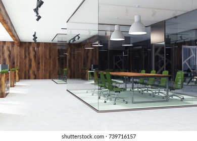 Environment friendly style office interior with a concrete floor, glass walls, a long meeting room table and green armchairs. Beds with grass in the background. Side view. 3d rendering