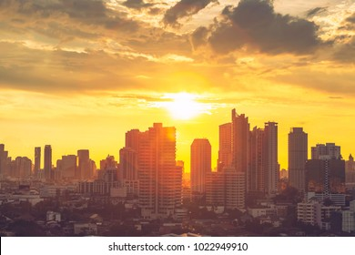 Environment and pollution concept. High modern building in Bangkok downtown and business city center with sun ray at sunset. Picture for add text message. Backdrop for design art work.