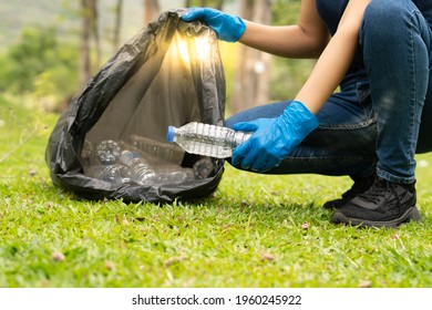 environment protection pollution problems and global warming,plastic waste caring about nature concept.Volunteer women carrying garbage bags, garbage collection, cleaning in the national park