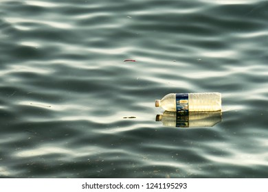 Environment sea pollution - Plastic bottle floating at the sea.