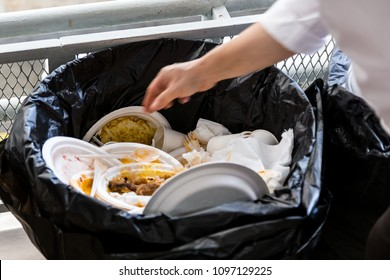 Environment unfriendly styrofoam plates and cups disposed in plastic garbage bag