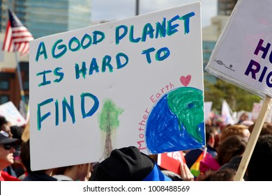 Environmental activism sign at the 2018 women's march in downtown San Diego on January 20, 2018.